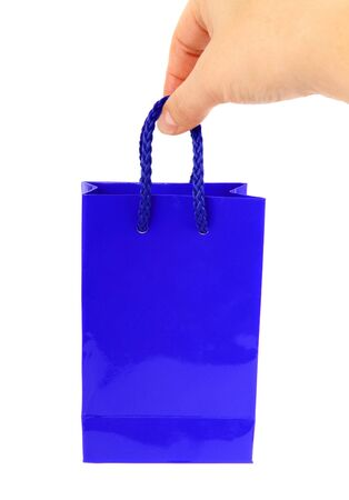 blue bag with hand isolated on white photo