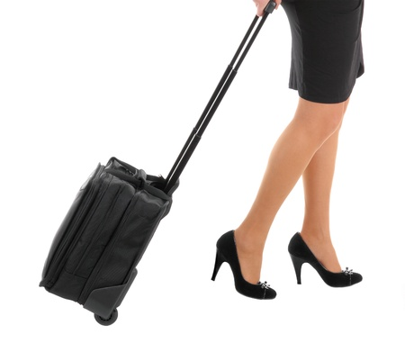 businesswoman legs: Businesswoman legs with a suitcase on the white background