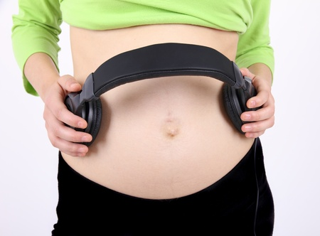 Headphones on a pregnant woman photo