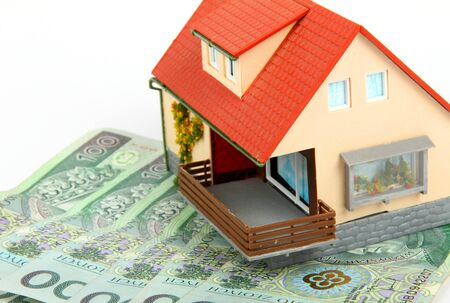 wasteful: polish money on house - loan for own home Stock Photo