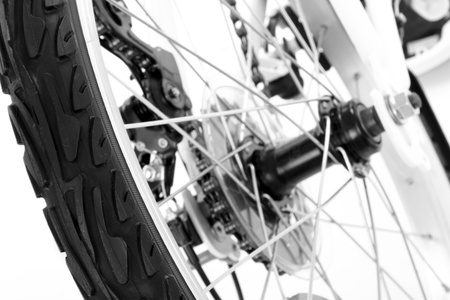 Wheel with tire of bicycle isolated on white  photo