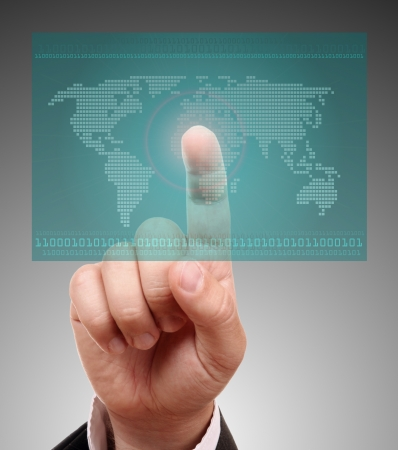 finger touching world map on a touch screen stock photo picture and