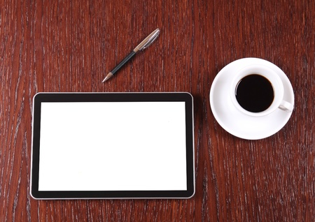 note pad and pen: Tablet, coffee and pen on the desk