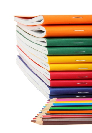 exercise books and pencils, close up  photo