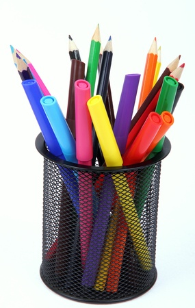 colorful pencils in holder isolated on white background photo