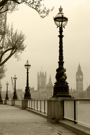 street shot: Big Ben   Houses of Parliament, view in fog in sepia tone