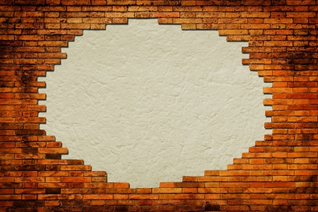 Grungy paper background surrounded by brick frame isolated  photo