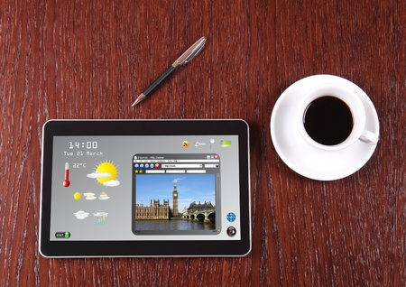 forcast: Tablet, coffee and pen on the desk