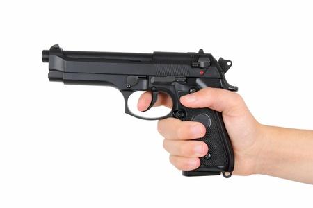 Main avec un pistolet, isolé sur fond blanc Banque d'images