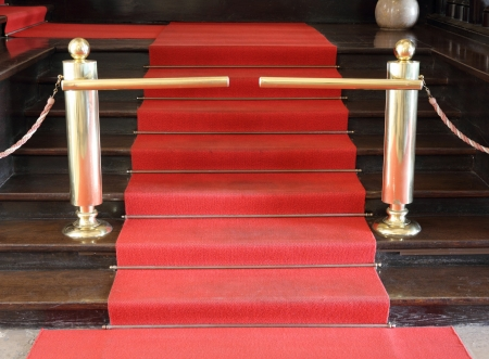 Red security rope by red carpet
