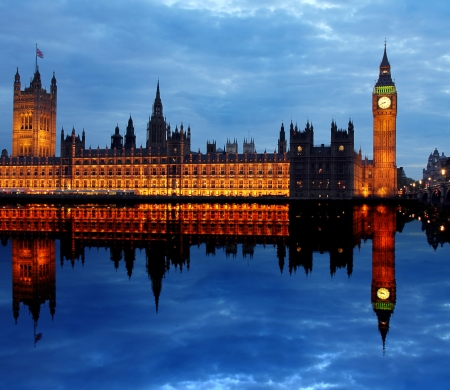 Westminster Bridge with Big Ben in London,  of reflection in the river photo