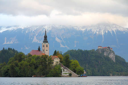 Lake Bled with island, castle and mountains in background, Slovenia, Europe photo