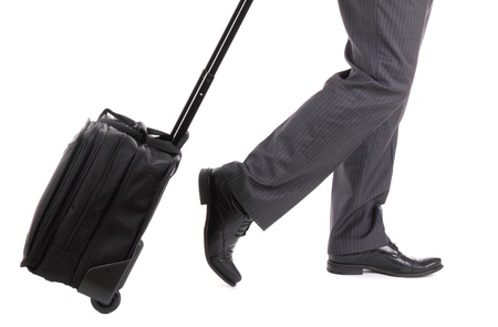 business traveler: A business traveler with suitcase on white