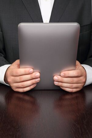 Businessman reading news on digital tablet photo