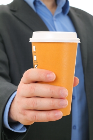 Businessman with paper coffee cup, take away photo