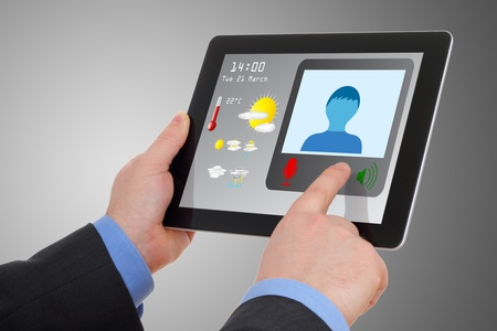 portals: Businessman using tablet to videoconference, meet online, comunicate