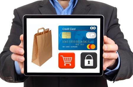 Empresario presentar compra segura en un equipo Tablet PC digital (pantalla aislada) Foto de archivo