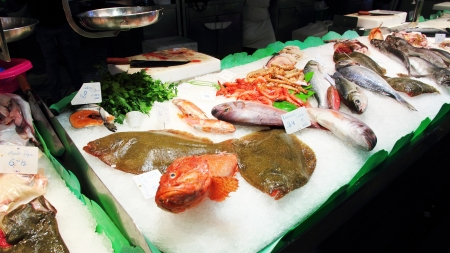 view of fish displayed at a fish market in Barcelona photo