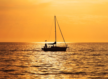 Romantic journey: sea, sunset and yacht photo