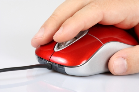 office use: Computer mouse and mens hand Stock Photo
