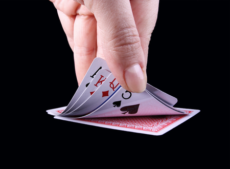 Hand open to see cards  photo