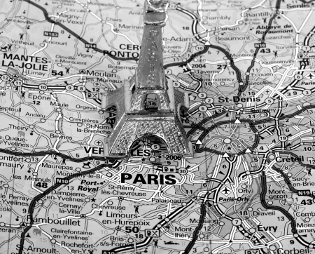 Eiffel Tower on a map of Paris, short focus,  black and white version. Zdjęcie Seryjne