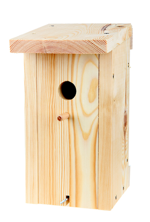 Wooden birdhouse isolated over white photo