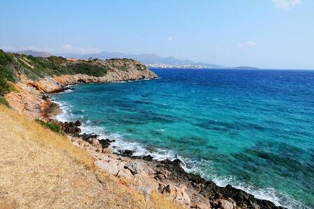 view on blue sea with rocks on Crete, Greece photo