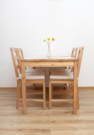Dinning table and chairs  in empty  room. photo