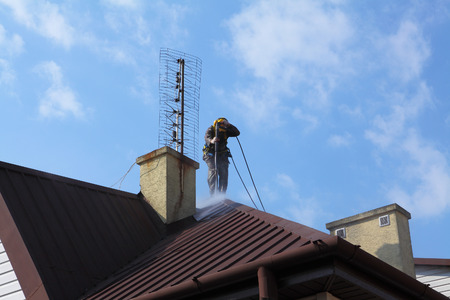 industrial noise: Professional roof washing.