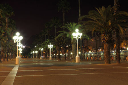 Empty promenade with night lamps, Barcelona, ​​Spain photo