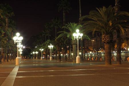 Empty promenade with night lamps, Barcelona, Spain photo
