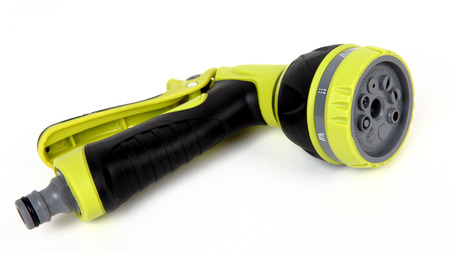 nozzle: Green garden water hose with adjustable spray nozzle