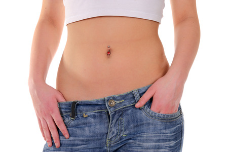 navel piercing: belly(and earring) of a beauty young woman on white background
