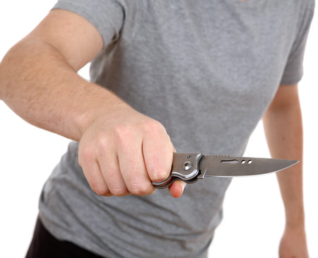 slayer: young man holding knife isolated on white background