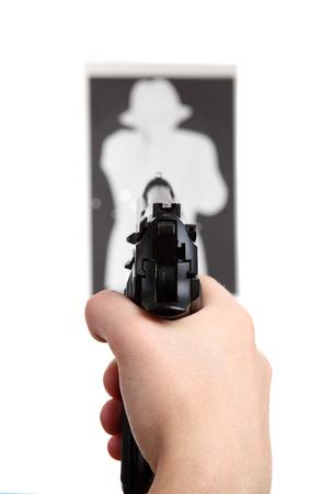 shooting at goal: hand with gun shooting target Stock Photo