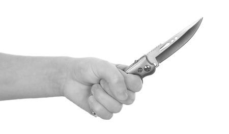 hand holding knife isolated on white background