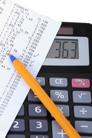 household money: A calculator with receipt, household bills Stock Photo