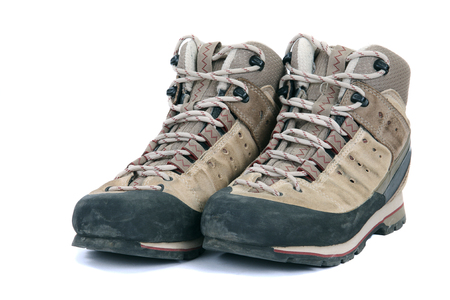 Old scuffed hiking boots on white background Stock Photo