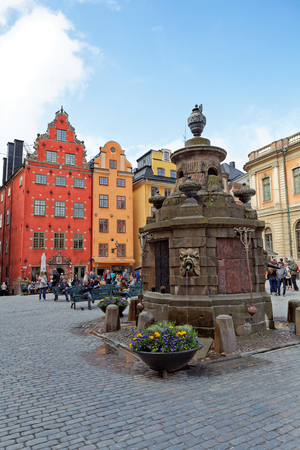 Stockholm, Sweden - 29 May 2016.  Tourists admire the famous square Stor Torget square. Houses Dating from the 17th Century in Stor-Torget, Stor Square. Editorial