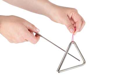 Metal triangle on white background, music instrument Imagens - 66726072