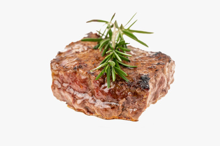 Grilled steak with rosemary on top isolated on white background Stockfoto