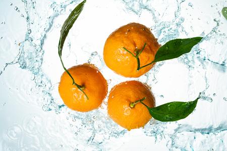 Oranges Water Splash on white background