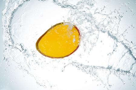 Mango Water Splash on white background Imagens