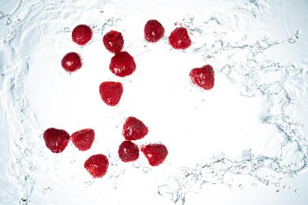 Raspberries Water Splash on whitebackground