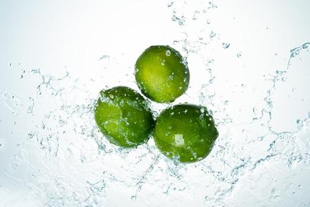 Limes Water Splash on white background