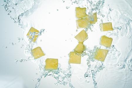 Pineapple Water Splash on White Baclground Imagens