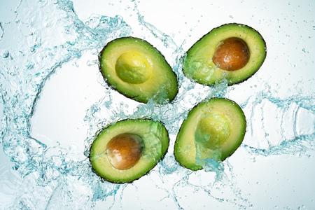 Avocado Water Splash on white background
