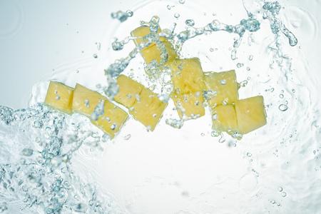 Pineapple Water Splash on White Background