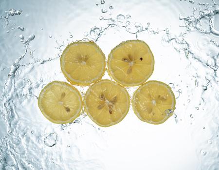Lemons Water Splash on white background Imagens